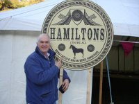 Glyn at Llanthony Show and Country Fair by marquee sign for Film Resistance November 2010